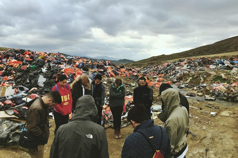 USC students pray in field of discarded life jackets