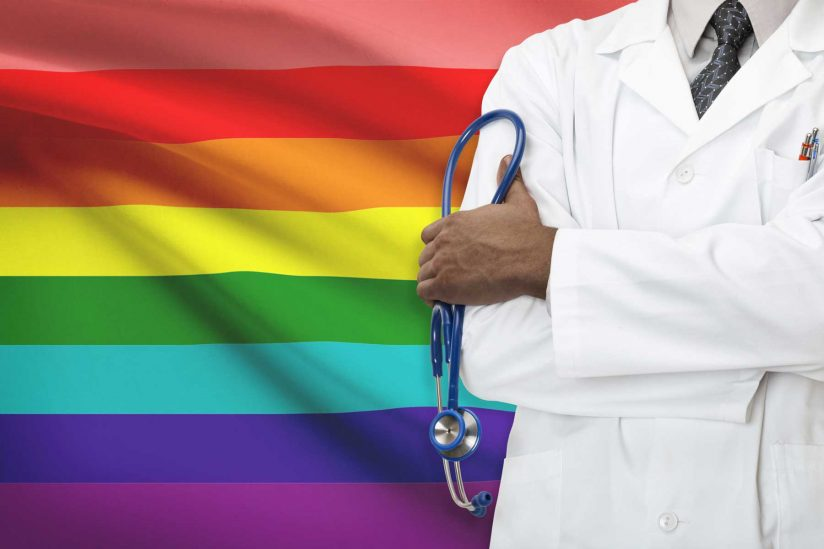 Composite of doctor holding stethoscope in front of background of rainbow flag
