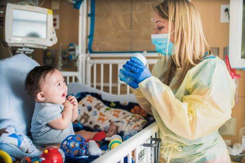 Baby working with therapist Kimberly Grenawitzke