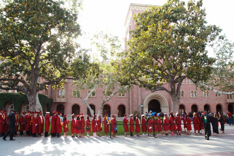 Hybrid high graduates line up in front of Bovard for a ceremony