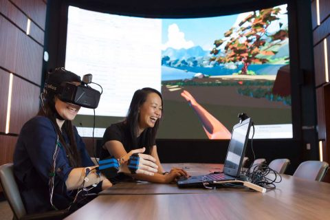Sook-Lei Liew showing VR software in conference room