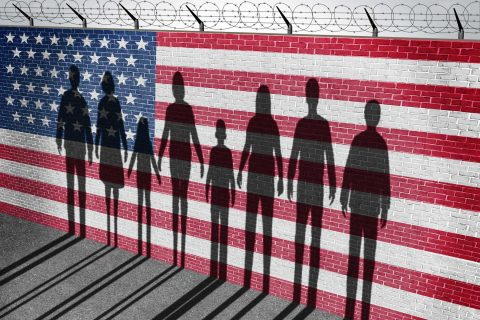 Illustration with silhouettes in front of American flag covering fence with barbed wire
