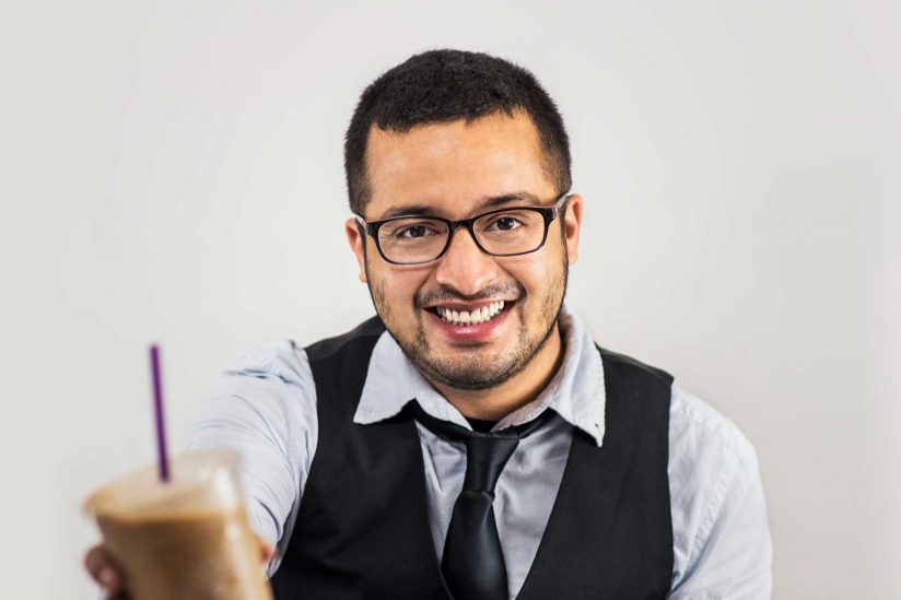 Portrait of barista James Augspurger holding a coffee