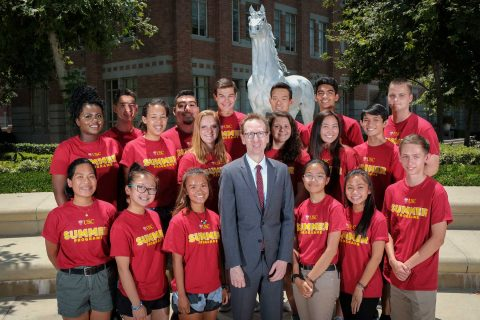 Group photo of students with Michael Quick