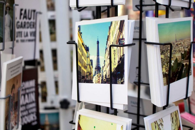 rack of postcards showing picturesque Eiffel tower