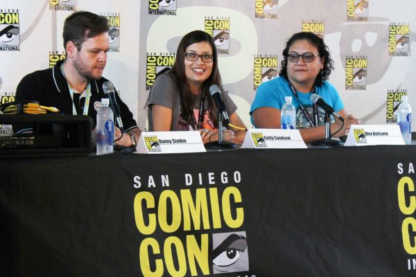 Emily Sandoval and two others seated at a panel at Comic-con