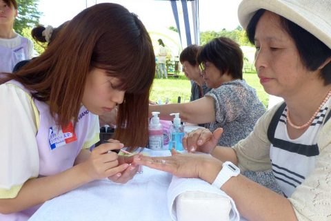 Japanese beauticians giving manicures to senior women