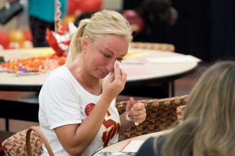 Ann Ilibasic cries while writing letter