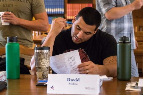 David Molina going over notes in library