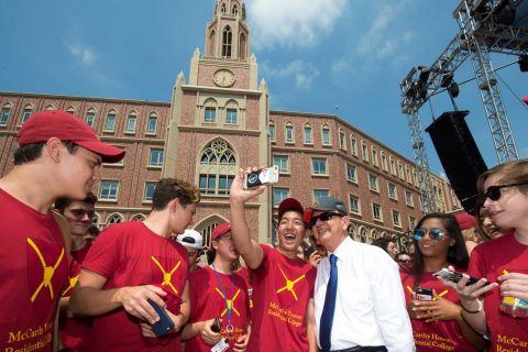 students taking selfies with president Nikias
