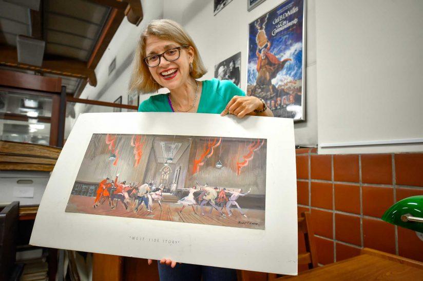 Sandra Garcia-Myers holding story board