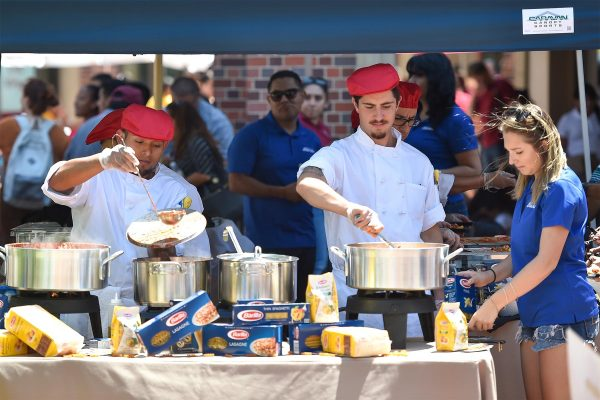 Barilla workers serve food to open house guests
