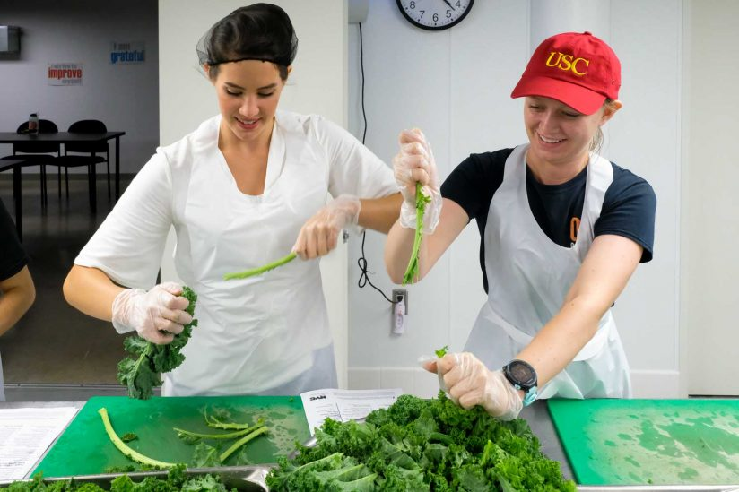 students preparing kale