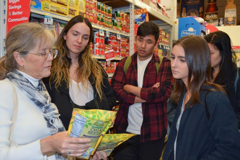 Cary Kreutzer visits grocery store with students