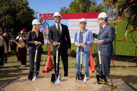 Erica Muhl, Andre Young, Jimmy Iovine and Max Nikias with shovels at groundbreaking
