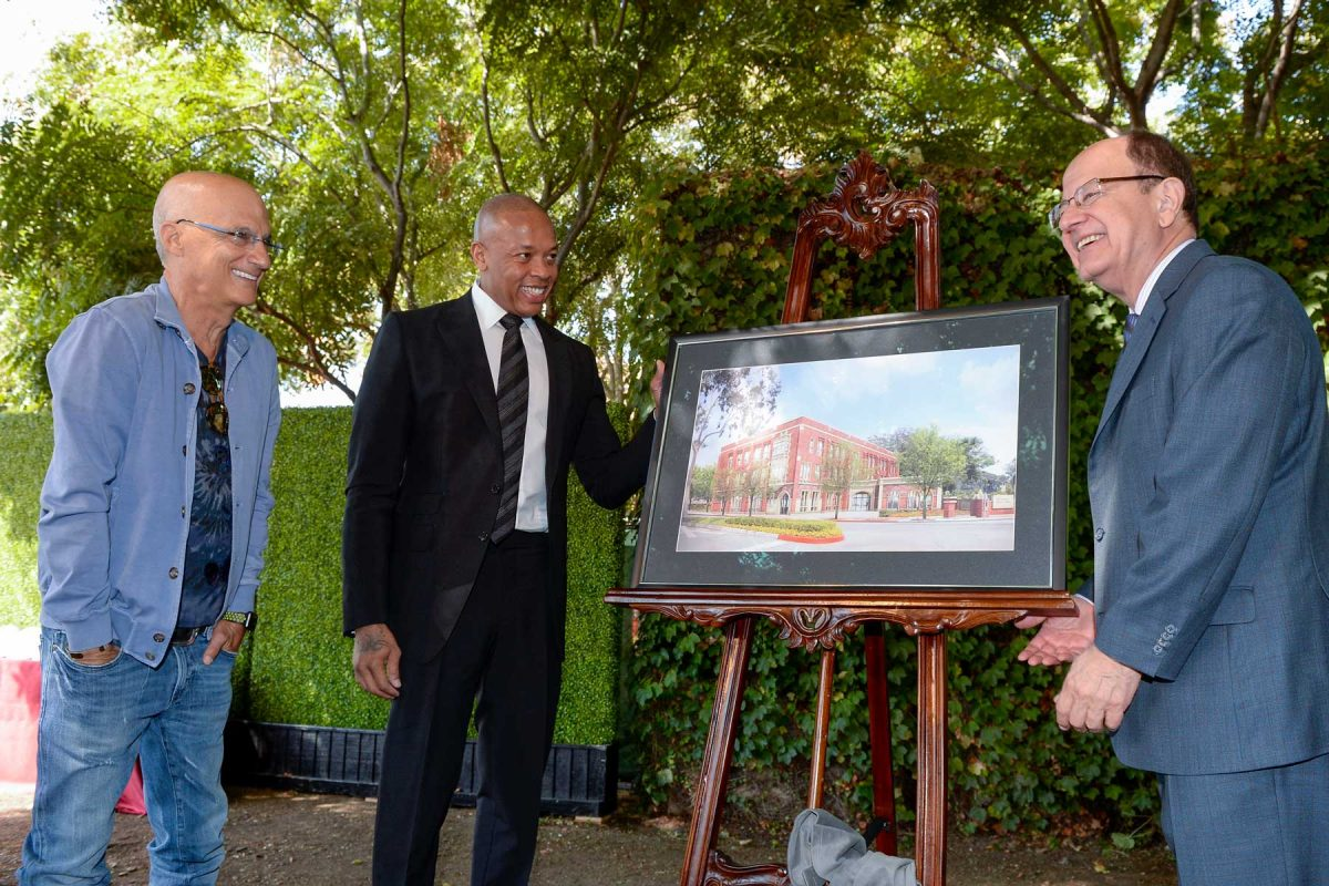 Jimmy Iovine, Andre Young and President and Nikias looking at rendering