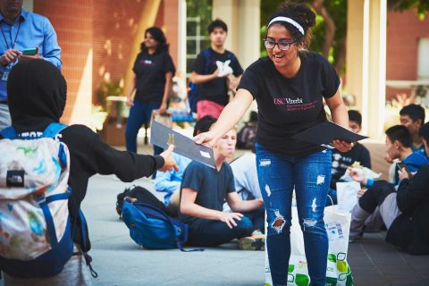 Leslie Guandique in courtyard during paper airplane competition