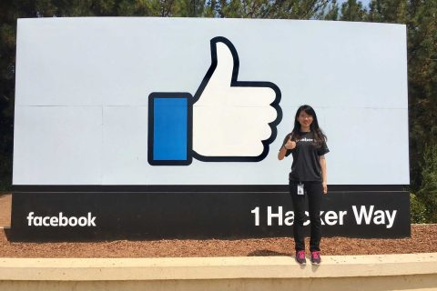 Qinqin Zhu in front of facebook sign at 1 Hacker Way