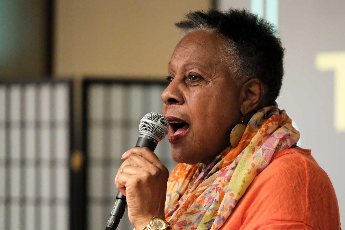 Rose Monteiro speaks into mic