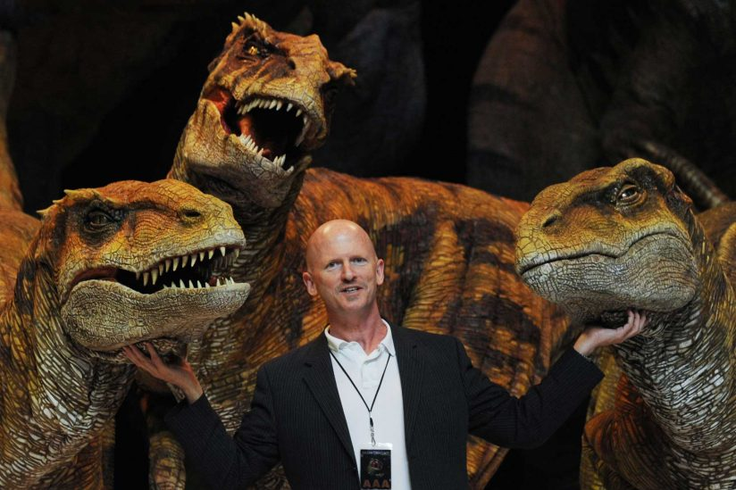 "Scott Faris with the dinosaurs from London Walking With Dinosaurs"" production"