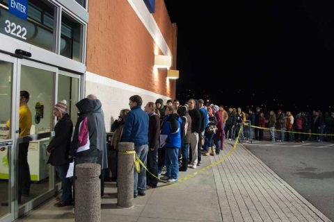 People waiting in line at Best Buy at midnight