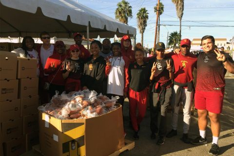 USC track and field team members take a break during Tuesday's distribution of Thanksgiving turkeys and groceries