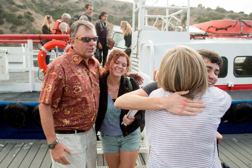 John and Julie Mork hugging students
