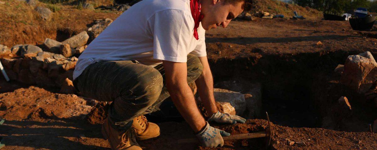 Max Novak at dig site in Greece