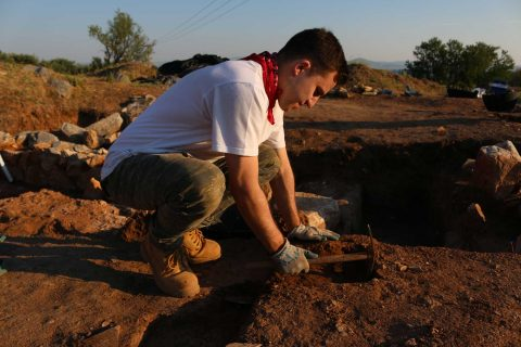 Max Novak at dig site in Greece