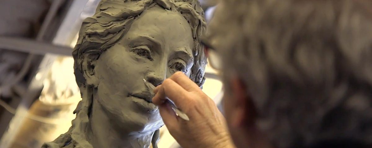 Sculptor Christopher Slatoff works on the statue of Hecuba, queen of Troy