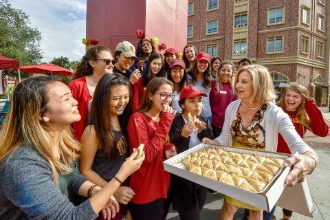 Niki C. Nikias, wife of USC President C. L. Max Nikias, brings Greek pastries to the Helenes