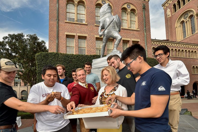 Trojan Knights dig into Greek pastries brought by Niki C. Nikias