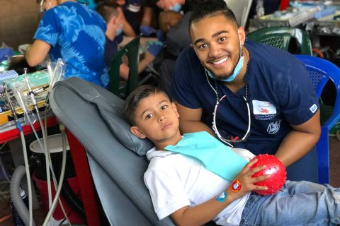 Dentist student posing with pediatric patient