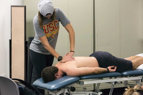 PT students doing spine exam