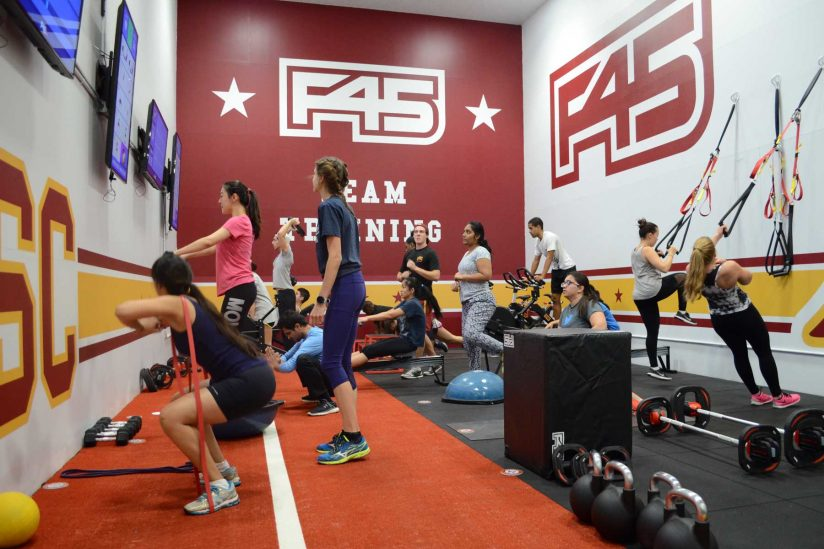 students working out in F45 room