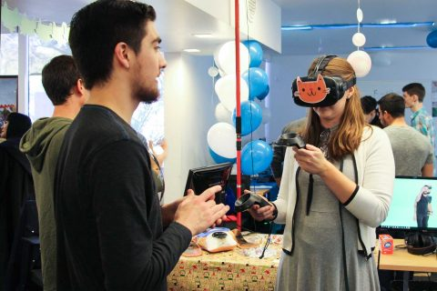 "GamePipe Laboratory Demo Day visitors test ""Fan the Cannon,"" a VR game"