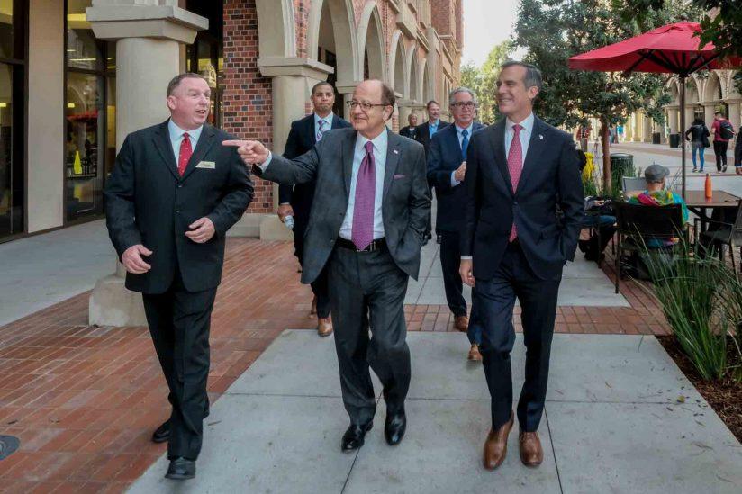 Dan Moran, USC President C. L. Max Nikias and L.A. Mayor Eric Garcetti tour USC Village