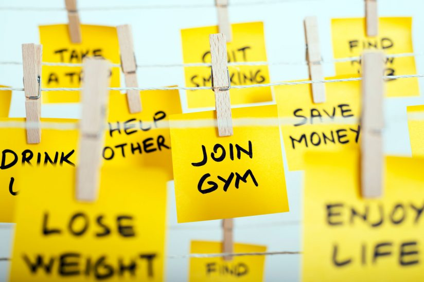 Tips to making New Year's resolutions stick: Post-it notes with resolutions
