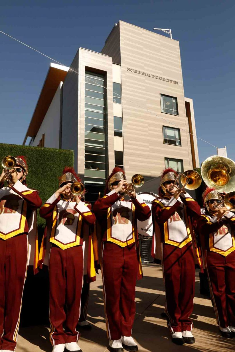 Trojan Marching Band with Norris Healthcare Center in background
