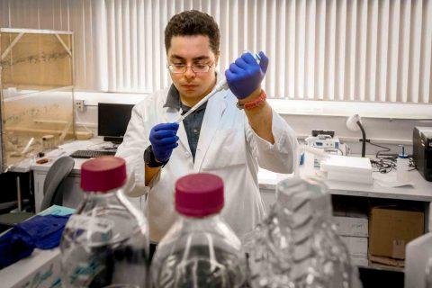 Sina Kiamehr working in a lab