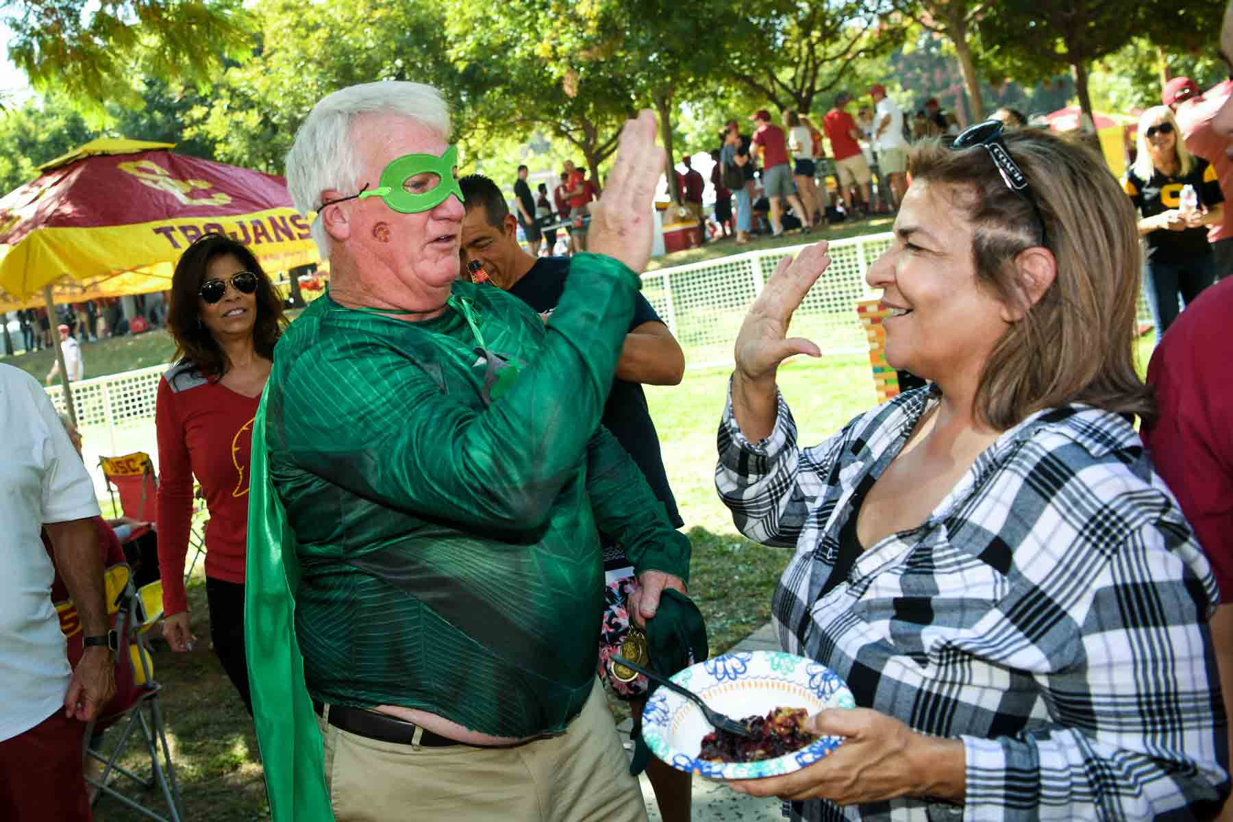 Recycle Man high-fiving a USC tailgater