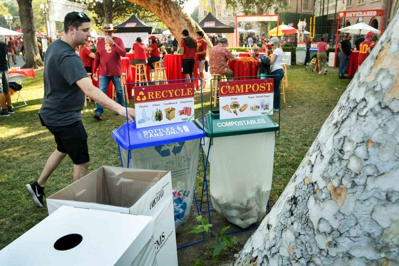 USC fan throws can in recycling
