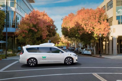 Fully self-driving minivan on the road