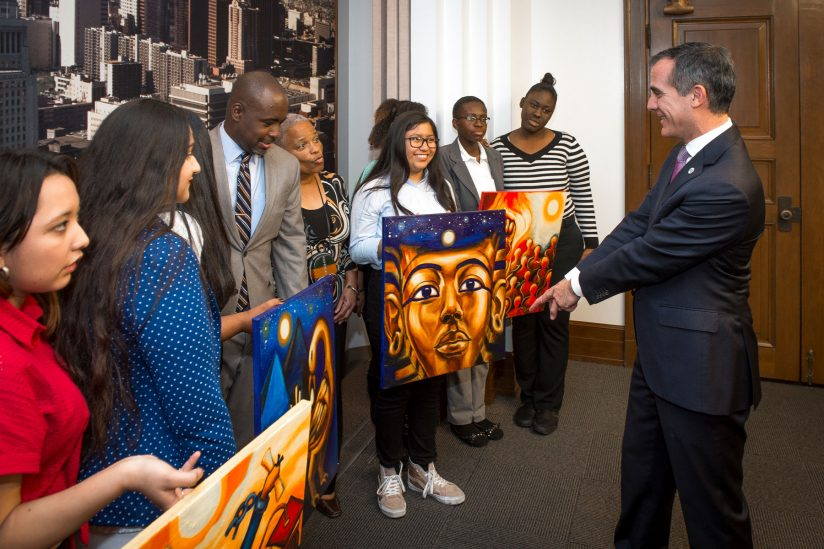 Eric Garcetti with students and Black History Month banners