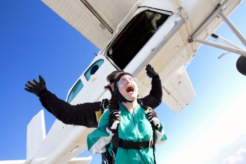 scared skydiver doing a tandem jump