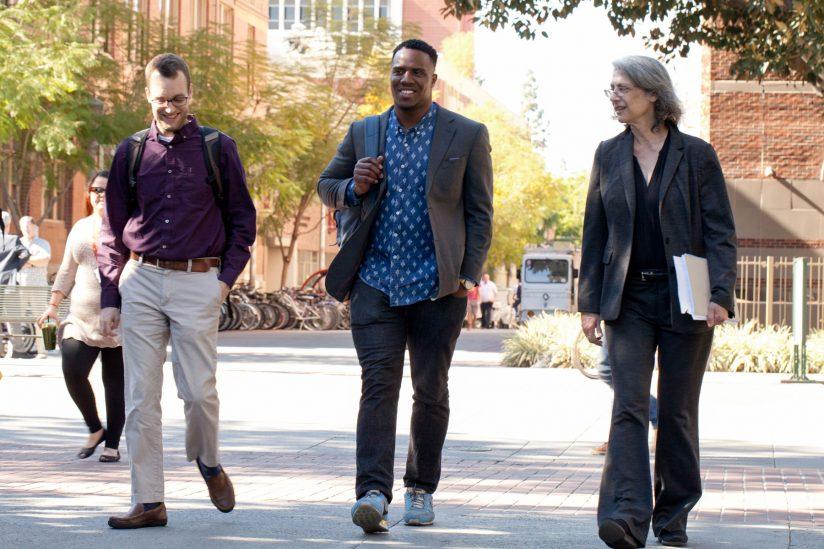 Elyn Saks, founder of USC's Saks Institute, walking with USC Alumni