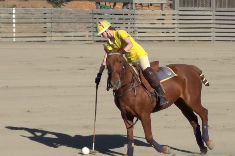 Richelle playing polo