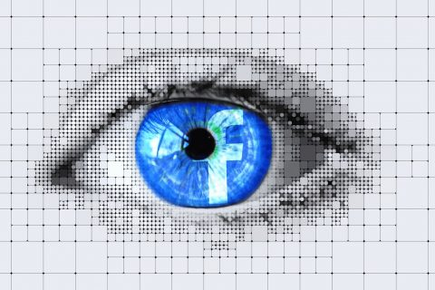 Graphic the future of facebook: blue logo reflected in eye