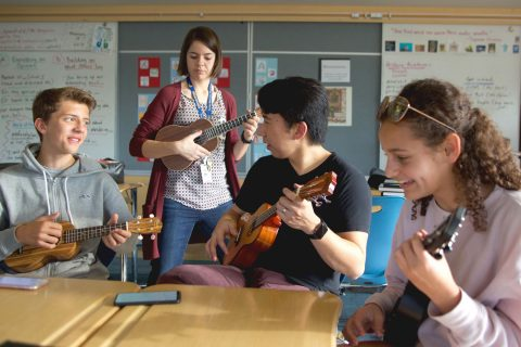 Jim Wang teaches ukulele in music class