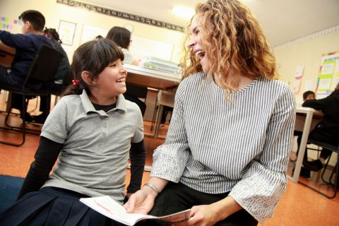 Hattie Mitchell interacts with Crete students